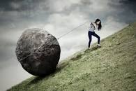 pulling a rock uphill
